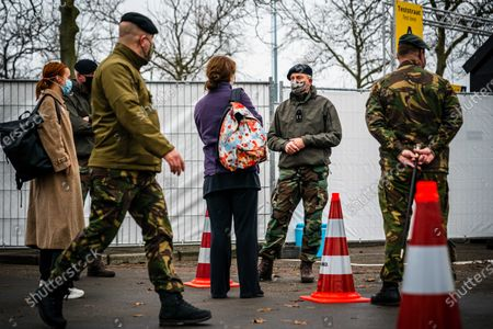 Stock Photo of Commander of the Dutch Armed Forces Rob Bauer (2-R) talks to people at the XL test street in Eindhoven, Netherlands, 02 December 2020. Soldiers from the base in Oirschot offered their assistance in carrying out corona tests at the facility.