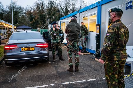Stock Picture of Commander of the Dutch Armed Forces Rob Bauer (2-R) talks to soldiers at the XL test street in Eindhoven, Netherlands, 02 December 2020. Soldiers from the base in Oirschot offered their assistance in carrying out corona tests at the facility.