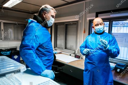Commander of the Dutch Armed Forces Rob Bauer (L) talks to a health personnell at the XL test street in Eindhoven, Netherlands, 02 December 2020. Soldiers from the base in Oirschot offered their assistance in carrying out corona tests at the facility.