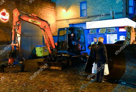 Stock Photo of Coronation Street - Ep 10189 & Ep10190 Wednesday 9th December 2020 As Ken Barlow, as played by William Roache, stands in the bulldozer's path as Abi Franklin, as played by Sally Carman, jumps into the cab of the digger but loses control of the long arm, which smashes down on a nearby substation, knocking out all the power in the surrounding streets.