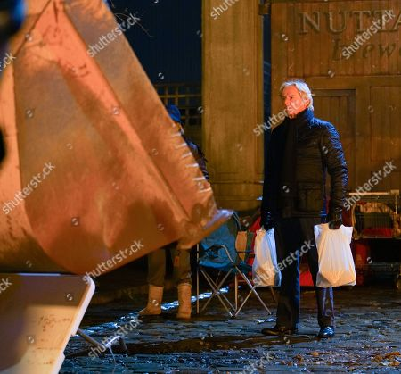 Stock Image of Coronation Street - Ep 10189 & Ep10190 Wednesday 9th December 2020 As Ken Barlow, as played by William Roache, stands in the bulldozer's path Abi Franklin, jumps into the cab of the digger but loses control of the long arm, which smashes down on a nearby substation, knocking out all the power in the surrounding streets.