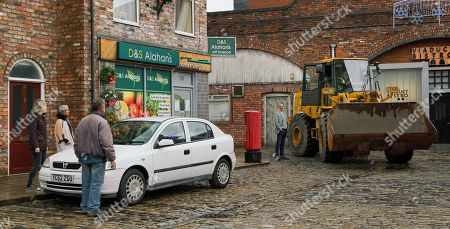Stock Photo of Coronation Street - Ep 10187 & Ep 10188 Monday 7th December 2020 On the street, Abi Franklin, as played by Sally Carman, Kevin Webster, as played by Michael Le Vell, Debbie Webster, as played by Sue Devaney, Brian, Cathy, David, Ken, Rita and Shona watch with horror as a bulldozer heads towards the brewery. Ray Crosby gives them a satisfied grin. The residents set up camp in front of the brewery and Rita Tanner leads them in a rousing rendition of 'We shall not be Moved''. Can they really defeat Ray and save the cobbles?