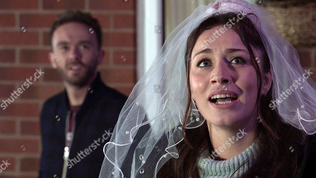 Stock Image of Coronation Street - Ep 10204 & Ep 10205 Friday 25th December 2020 David Platt, as played by Jack P Shepherd, and Shona Platt, as played by Julia Goulding, with the help of Max Turner and Lily Platt, re-enact their wedding day. As the Platts tumble out of No.8, the snow begins to fall and Shona stares up in wonderment. David gazes at his wife, his love for her renewed.
