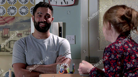 Stock Image of Coronation Street - Ep 10204 & Ep 10205 Friday 25th December 2020 After a sleepless night with baby Mason, Toyah Battersby, as played by Georgia Taylor, excitedly and Imran Habeeb, as played by Charlie de Melo, share a smile, happy but slightly out of their depth.