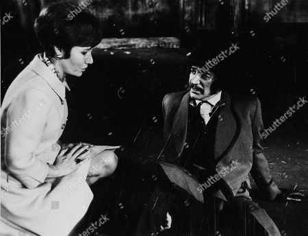 Patricia English as Mrs. Taylor and Peter Wyngarde as Jason King