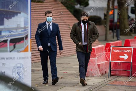 PC WILLIAM GEORGE SAMPSON (l) arrives at Leeds Magistrates Court with a representative of the Police Federation (r).