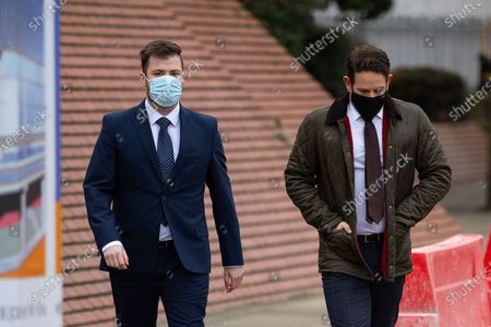 Stock Image of PC WILLIAM GEORGE SAMPSON (l) arrives at Leeds Magistrates Court with a representative of the Police Federation (r).
