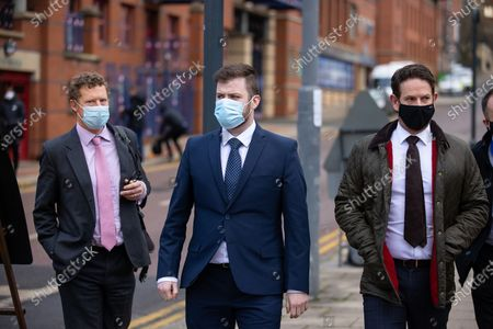 Stock Picture of PC WILLIAM GEORGE SAMPSON (c) leaves Leeds Magistrates Court with barrister JAMES BOURNE-ARTON (l) and a representative of the Police Federation (r).