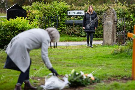 Stock Photo of Emmerdale - Ep 8909 Wednesday 9th December 2020 In the graveyard, Harriet Finch's, as played by Katherine Dow Blyton, distracted by a woman standing at the grave where Malone's buried.