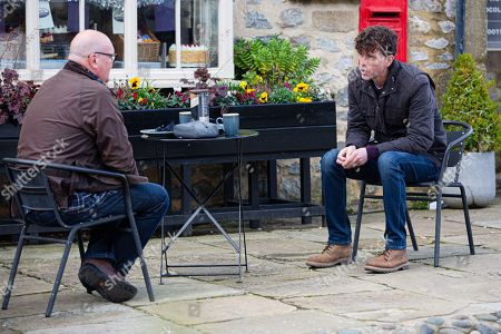 Emmerdale - Ep 8908 Tuesday 8th December 2020 Paddy Kirk, as played by Dominic Brunt, and Marlon Dingle, as played by Mark Charnock, conspire together about the wedding.