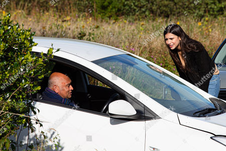 Stock Picture of Emmerdale - Ep 8907 Monday 7th December 2020 Rishi Sharma, as played by Bhasker Patel, has accidentally driven off the road. He is slumped against his steering wheel, semi-conscious. Meena, as played by Paige Sandhu, manages to find Rishi's whereabouts and is quite the hero as she rescues him.