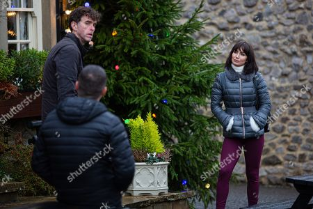 Stock Image of Emmerdale - Ep 8922 & Ep 8923 Thursday 24th December 2020 Marlon Dingle, as played by Mark Charnock, and Aaron Dingle, as played by Danny Miller, are relieved when Leyla Harding, as played by Rokhsaneh Ghawam-Shahidi, agrees to help them.