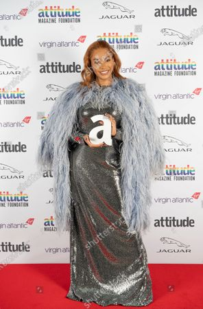 Stock Picture of Munroe Bergdorf with The Hero Award