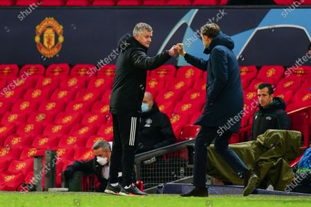 Coach-Ole Gunnar Solskjaer of Manchester United fist-pumps Paris Saint-Germain manager Thomas Tuchel at the final whistle