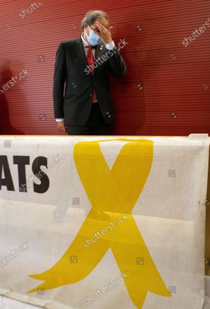 Former Catalan President Quim Torra poses during the handover ceremony of the conflictive banner in support of the Catalan imprisoned political leaders to the Catalan Museum of History in Barcelona, Spain, 02 December. Torra was barred from office for disobedience after he refused to remove the banner in support of jailed leaders.