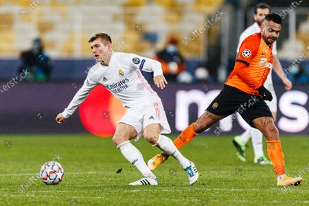Stock Image of Toni Kroos of Real Madrid (L) plays against Bruno Ferreira of Shakhtar (R)