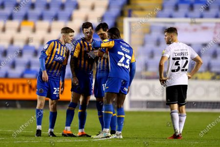 Stock Picture of Shrewsbury Town players Scott High, Ollie Norburn, Charles Daniels and Daniel Udoh examine a note passed to them by manager Steve Cotterill