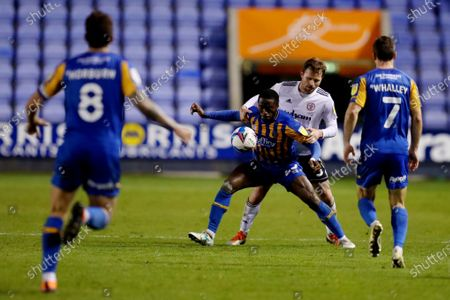 Stock Image of Daniel Udoh of Shrewsbury Town and Mark Hughes of Accrington Stanley