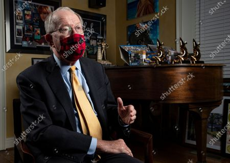 Sen. Lamar Alexander, R-Tenn., speaks from behind a face mask during an interview in Nashville, Tenn
