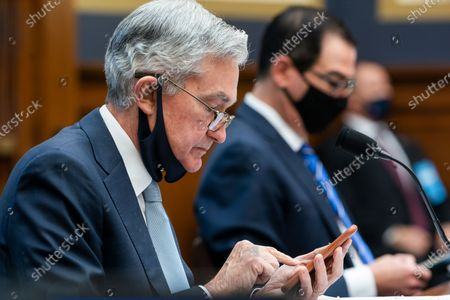Federal Reserve Chair Jerome Powell, left, and Treasury Secretary Steven Mnuchin arrive to testify before a House Financial Services Committee hearing on Capitol Hill in Washington