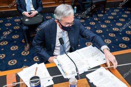 Federal Reserve Chair Jerome Powell prepares to testify before a House Financial Services Committee hearing on Capitol Hill in Washington