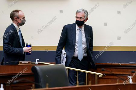 Federal Reserve Chairman Jerome Powell, right, arrives for a House Financial Services Committee hearing on Capitol Hill in Washington