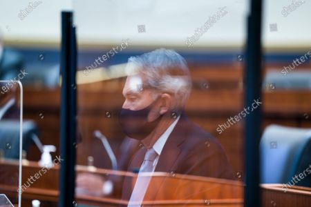 Stock Picture of Federal Reserve Chair Jerome Powell is seen in a reflection as he testifies before a House Financial Services Committee hearing on Capitol Hill in Washington