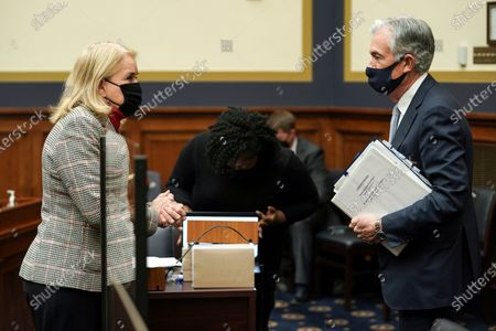 Rep. Sylvia Garcia, D-Texas, speaks to Federal Reserve Chairman Jerome Powell after a House Financial Services Committee hearing on Capitol Hill in Washington