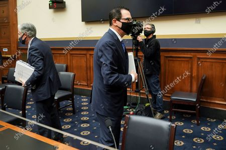 Federal Reserve Chairman Jerome Powell and Treasury Secretary Steven Mnuchin leave after a House Financial Services Committee hearing on Capitol Hill in Washington