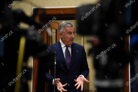 President of Montenegro Milo Djukanovic (C) gestures while speaking to the media during Prime Minister-designate Zdravko Krivokapic' presentation of his plans for a new government to the members of parliament in Podgorica, Montenegro, 02 December 2020. After the parliamentary elections on 30 August 2020, the ruling pro-Serb alliance 'For the Future of Montenegro', Civic Movement United Reform Action and coalitions 'Black or white' won the political mandate by gaining 41 of the 81 seats in parliament. Others are not identified.