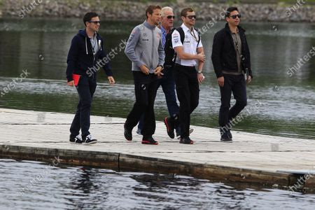 6th June 2013 Jenson Button, McLaren arrives at the track with his trainer, Mike Collier, and father, John Button World Copyright: Charles Coates/