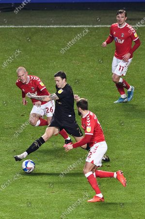 MK Dons' Midfielder Ben Gladwin (7) battles for possession  with Charlton Athletic midfielder Ben Watson (26) during the EFL Sky Bet League 1 match between Charlton Athletic and Milton Keynes Dons at The Valley, London