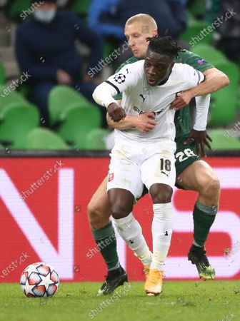 Rennes' Jeremy Doku and Krasnodar's Igor Smolnikov challenge for the ball during the UEFA Champions League, Group E, soccer match between Krasnodar and Rennes at the Krasnodar Stadium in Krasnodar, Russia