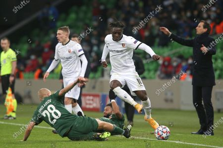 Krasnodar's Igor Smolnikov, left, and Rennes' Jeremy Doku challenge for the ball during the UEFA Champions League, Group E, soccer match between Krasnodar and Rennes at the Krasnodar Stadium in Krasnodar, Russia