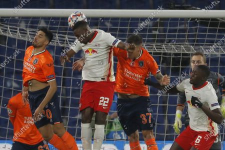 Leipzig's Nordi Mukiele, center, and Basaksehir's Berkay Ozcan, left, and Basaksehir's Martin Skrtel, second right, jump for he ball during the Champions League group H soccer match between Istanbul Basaksehir and RB Leipzig at Fatih Terim Stadim in Istanbul