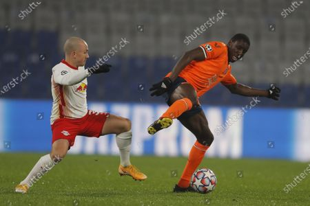Basaksehir's Demba Ba, right, controls the ball as Leipzig's Angelino tries to stop him during the Champions League group H soccer match between Istanbul Basaksehir and RB Leipzig at Fatih Terim Stadim in Istanbul