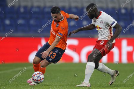 Stock Image of Basaksehir's Aziz Behich, left, controls the ball as Leipzig's Dayot Upamecano defends during the Champions League group H soccer match between Istanbul Basaksehir and RB Leipzig at Fatih Terim Stadium in Istanbul