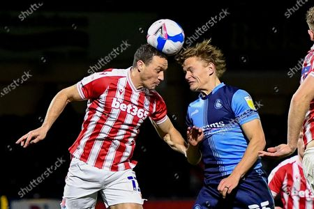 Stoke City defender James Chester (12) heads the ball  under pressure from Wycombe Wanderers striker Alex Samuel (25) during the EFL Sky Bet Championship match between Wycombe Wanderers and Stoke City at Adams Park, High Wycombe