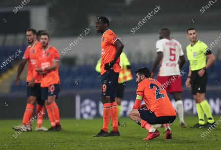 Mahmut Tekdemir (R) and Demba Ba (C) of Basaksehir react after the UEFA Champions League group H soccer match between Istanbul Basaksehir and RB Leipzig in Istanbul, Turkey, 02 December 2020.