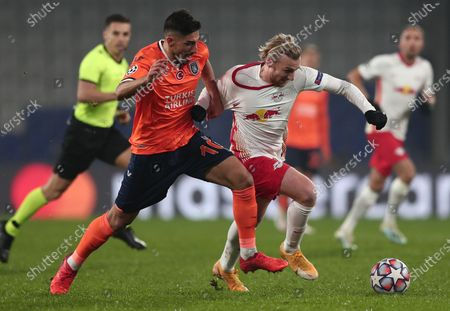 Berkay Ozcan (L) of Basaksehir in action against Emil Forsberg (R) of Leipzig during the UEFA Champions League group H soccer match between Istanbul Basaksehir and RB Leipzig in Istanbul, Turkey, 02 December 2020.