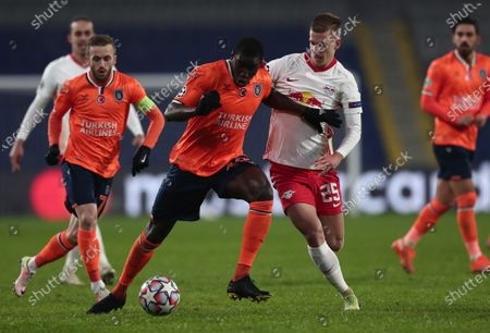 Demba Ba (C-L) of Basaksehir in action against Dani Olmo (C-R) of Leipzig during the UEFA Champions League group H soccer match between Istanbul Basaksehir and RB Leipzig in Istanbul, Turkey, 02 December 2020.