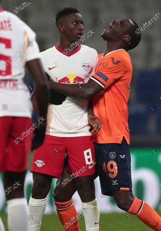 Demba Ba (R) of Basaksehir and Amador Haidara of Leipzig react during the UEFA Champions League group H soccer match between Istanbul Basaksehir and RB Leipzig in Istanbul, Turkey, 02 December 2020.