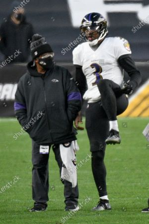 Baltimore Ravens quarterback Robert Griffin III (3) checks out his leg as he plays in an NFL football game against the Pittsburgh Steelers, in Pittsburgh