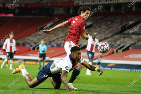Stock Photo of Manchester United's Edinson Cavani, right, challenges for the ball with PSG's Presnel Kimpembe during a Group H Champions League soccer match between Manchester United and Paris Saint Germain at the Old Trafford stadium in Manchester, England