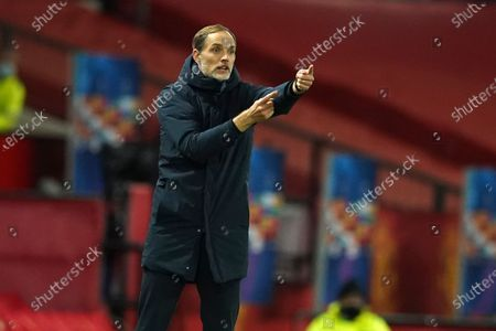 PSG's head coach Thomas Tuchel signals during a Group H Champions League soccer match between Manchester United and Paris Saint Germain at the Old Trafford stadium in Manchester, England