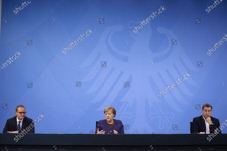 (L-R) Governing Mayor of Berlin Michael Mueller, German Chancellor Angela Merkel and Premier of Bavaria Markus Soeder attend a press conference after German Chancellor Merkel's video conference with German State Premiers about Coronavirus measures, in Berlin, Germany, 02 December 2020.