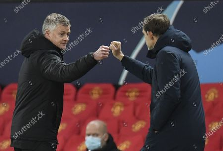 Manchester United's manager Ole Gunnar Solskjaer (L) greets Paris St Germain's coach Thomas Tuchel (R) the UEFA Champions League group H match between Manchester United and PSG in Manchester, Britain, 02 December 2020.