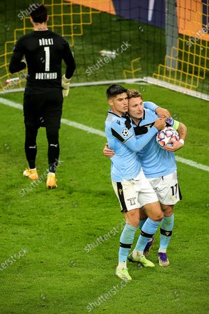 Lazio's Ciro Immobile (R) celebrates with teammate Joaquin Correa (C) after scoring the 1-1 equalizer from the penalty spot against Dortmund's goalkeeper Roman Buerki (L) during the UEFA Champions League group F soccer match between Borussia Dortmund and SS Lazio in Dortmund, Germany, 02 December 2020.