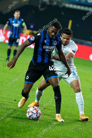 Brugge's Eder Balanta, left, is challenged by Zenit's Douglas Santos during a Champions league Group F soccer match between Brugge and Zenit at the Jan Breydel stadium in Bruges, Belgium
