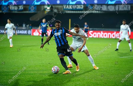 Brugge's Eder Balanta, center left, vies for the ball against Zenit's Douglas Santos during a Champions league Group F soccer match between Brugge and Zenit at the Jan Breydel stadium in Bruges, Belgium